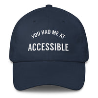 "front view of navy dad cap with the words"" YOU HAD ME AT ACCESSIBLE"" embroidered on the front"