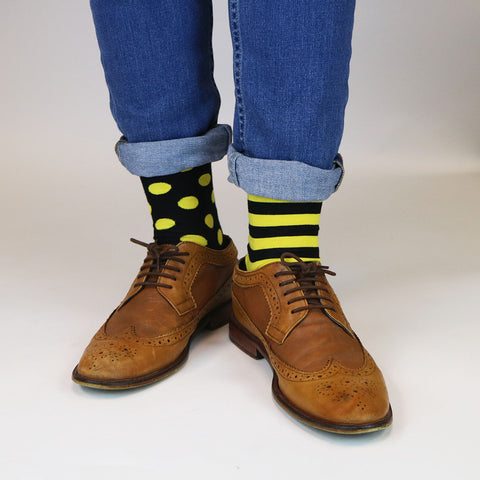 Yellow and Black Spotty and strip odd socks