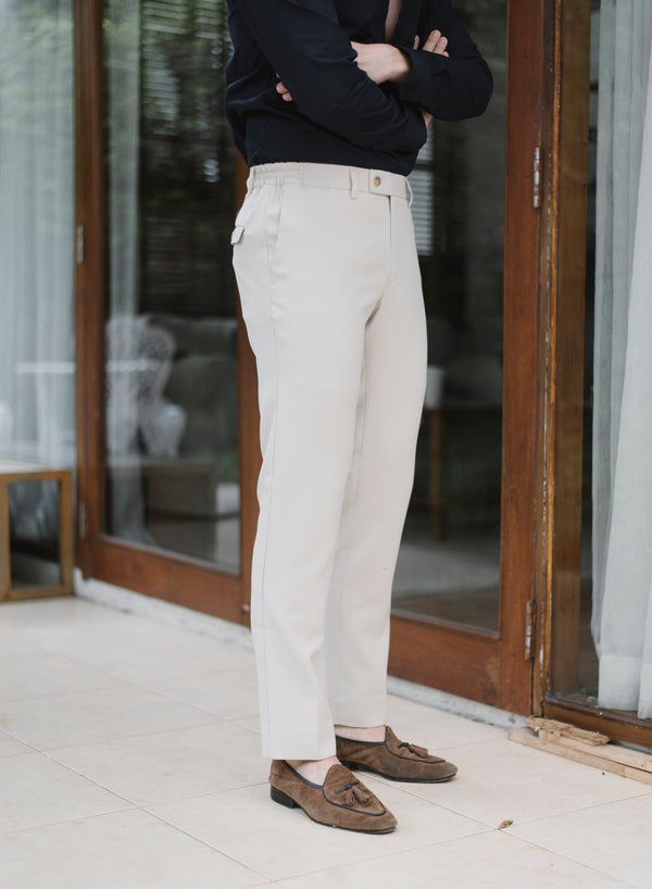 Beige trousers with side contrasting