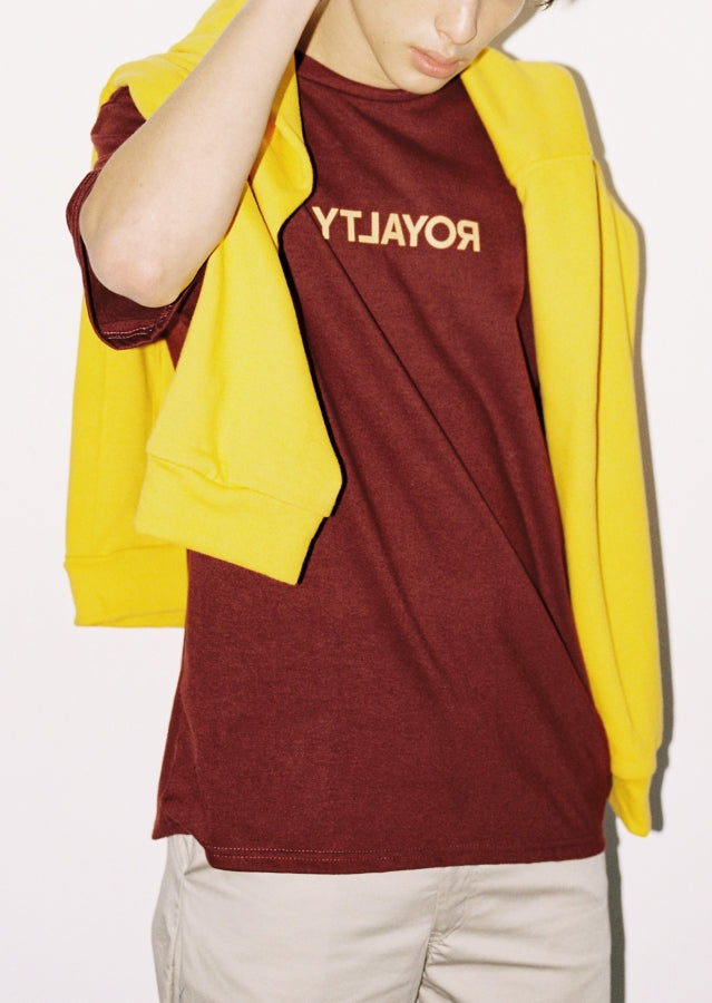 maroon shirt and yellow pull-over