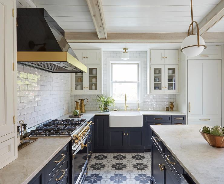 Were Drooling Over This Mediterranean Style Kitchen We Love The Subtle Warm Tones From Creamy White Upper Cabinets And Marble Countertops Paired With