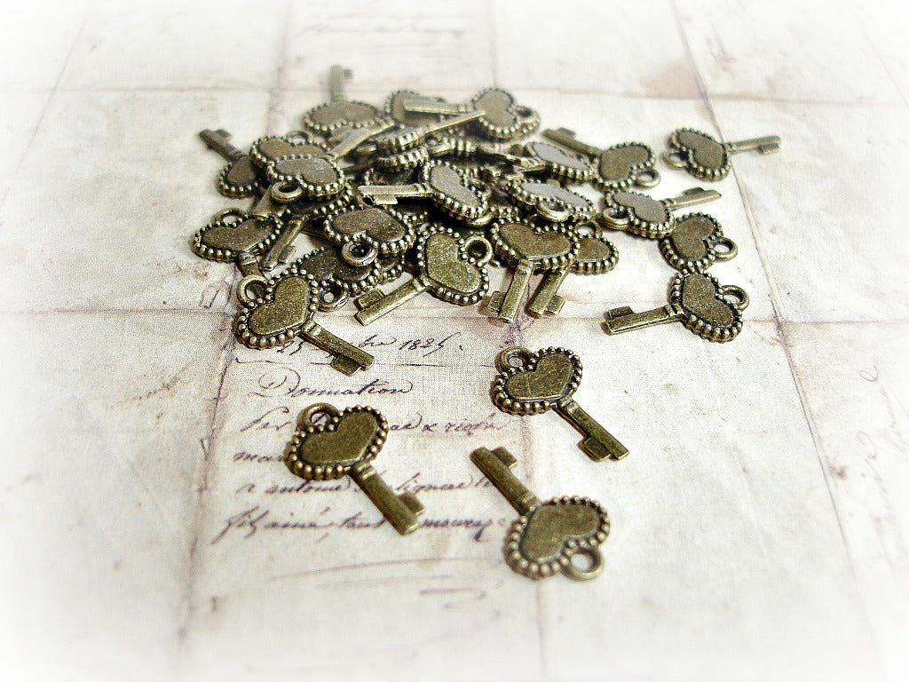 Antique Bronze Key Charms Frilled Heart