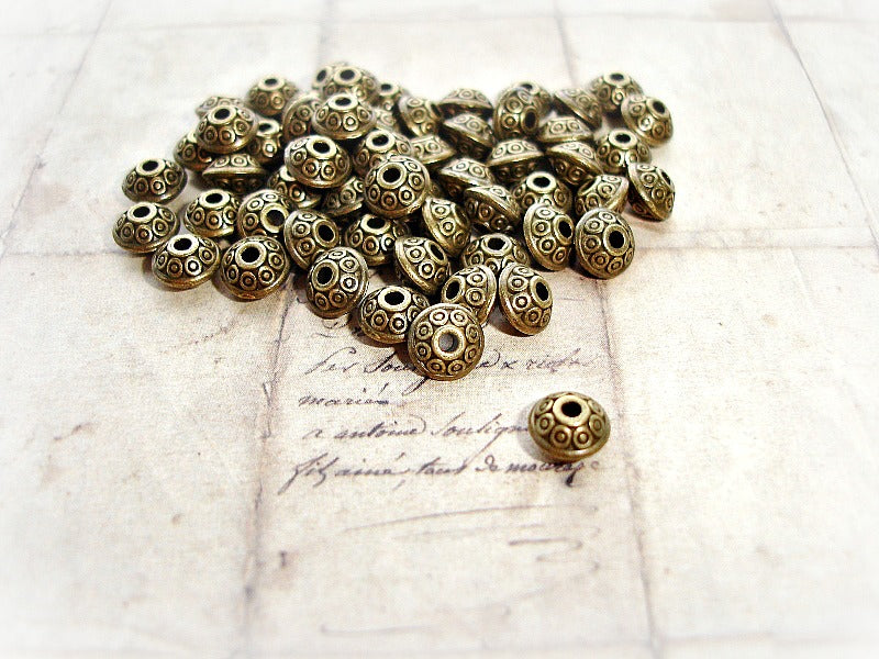 10 Antique Bronze Spacer Beads Circle Pattern