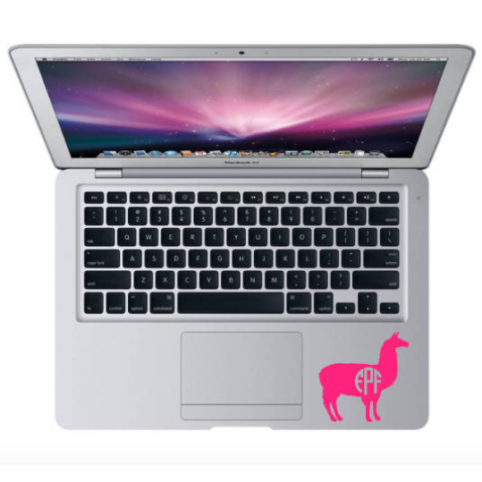 Monogrammed llama decal on macbook by track pad
