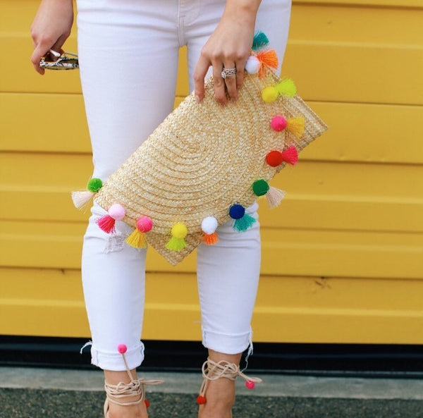 Straw pom pom clutch on model