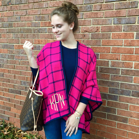 Pink and navy ruana wrap on model with purse
