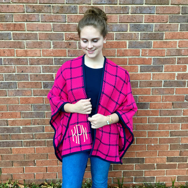 Pink and navy plaid ruana poncho wrap on model