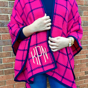 Close up of monogram on ruana poncho wrap