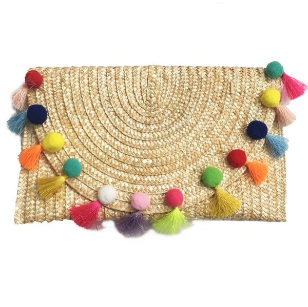 straw and pom pom clutch