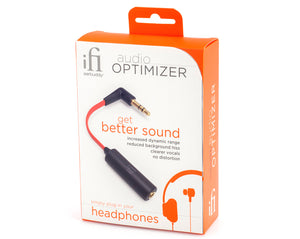 Packaging box on white background. The box is orange and yellow with a picture of the red and black ear plug interconnect. The packaging has headphones logo on it with descriptions of the product.