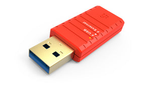 Red USB interconnect on white background. Interconnect plug with Super-Speed USB3.0 connectors. The USB port has gold and blue details