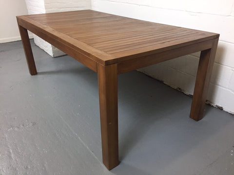 Image of teak dining table