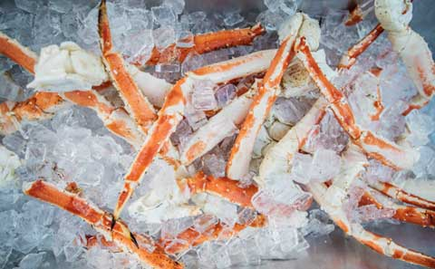 crab legs on ice