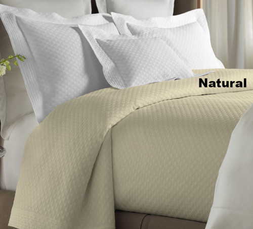 Alyssa natural coverlet shown on bed