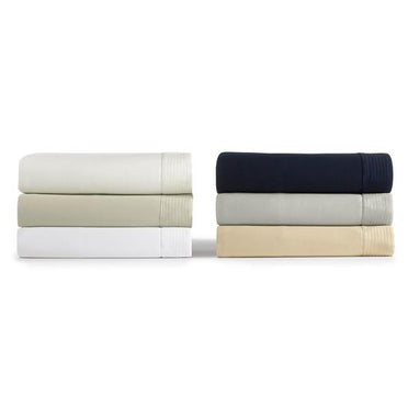 Angelina coverlet stack of colors