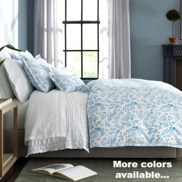 Alexandra bedding collection shown on bed