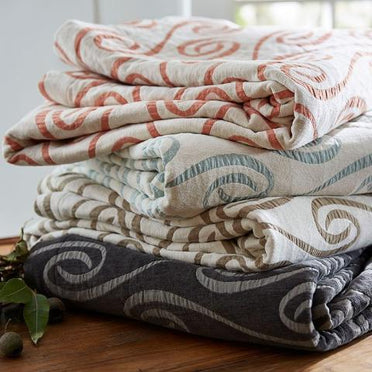 Stack of the many colors the Adlon coverlet is available in.