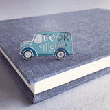 Bookmobile enamel pin by Rather Keen