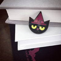 Cat Witch enamel pin with glow-in-the-dark eyes by Rather Keen.