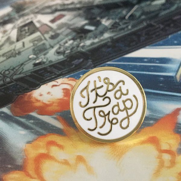 It's a Trap enamel pin by Rather Keen