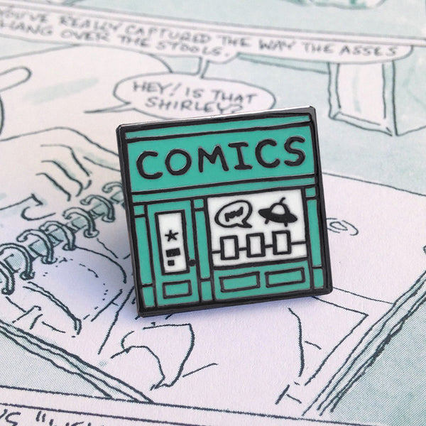 Comic Shop enamel pin