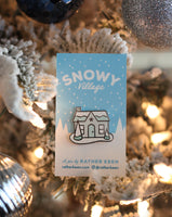 Snowy Glitter House enamel pin by Rather Keen.