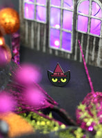Glow-in-the-dark Cat Witch enamel pin by Rather Keen.