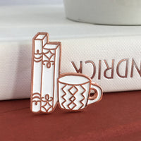 Rose Gold and White Books and Mug enamel pin by Rather Keen