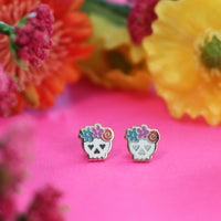 Sugar skull earrings by Rather Keen.