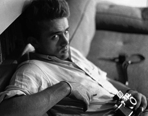 James Dean on the couch in Roy Schatt's apartment during a photography lesson 1954.