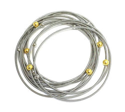 Silver Piano Wire Bracelet with Silver and Gold Beads