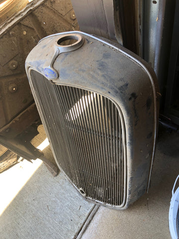 The unmistakable 1932 For grill shell.. this one wears a thick layer of barn dust.