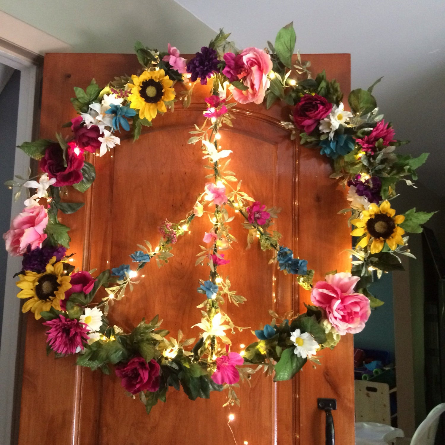 Giant fairy light floral peace sign