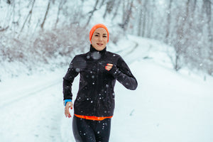 Woman running snow exercise outdoors