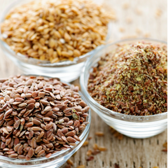 Bowls of nuts and seeds offering healthy fats to improve cognition, moods, pure energy, and immune system