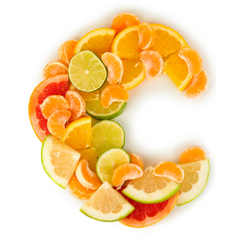 Oranges, grapefruits and other citrus fruits sliced in the shape of the letter C for Vitamin C