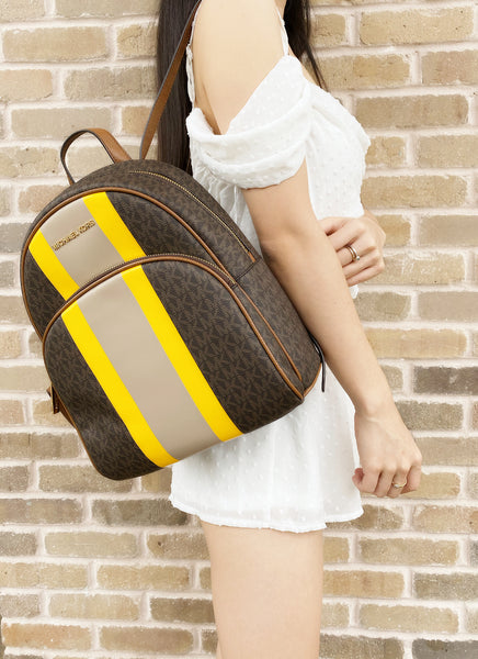 Michael Kors Abbey Medium Backpack Brown MK Signature Yellow Stripe - Gaby's Bags