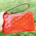 Michael Kors Jet Set Large Gusset Wristlet Patent Leather Mandarin MK Signature