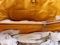 Coach F57842 Signature Drawstring Carryall Tote Khaki Brown Tangerine Orange - Gaby's Bags