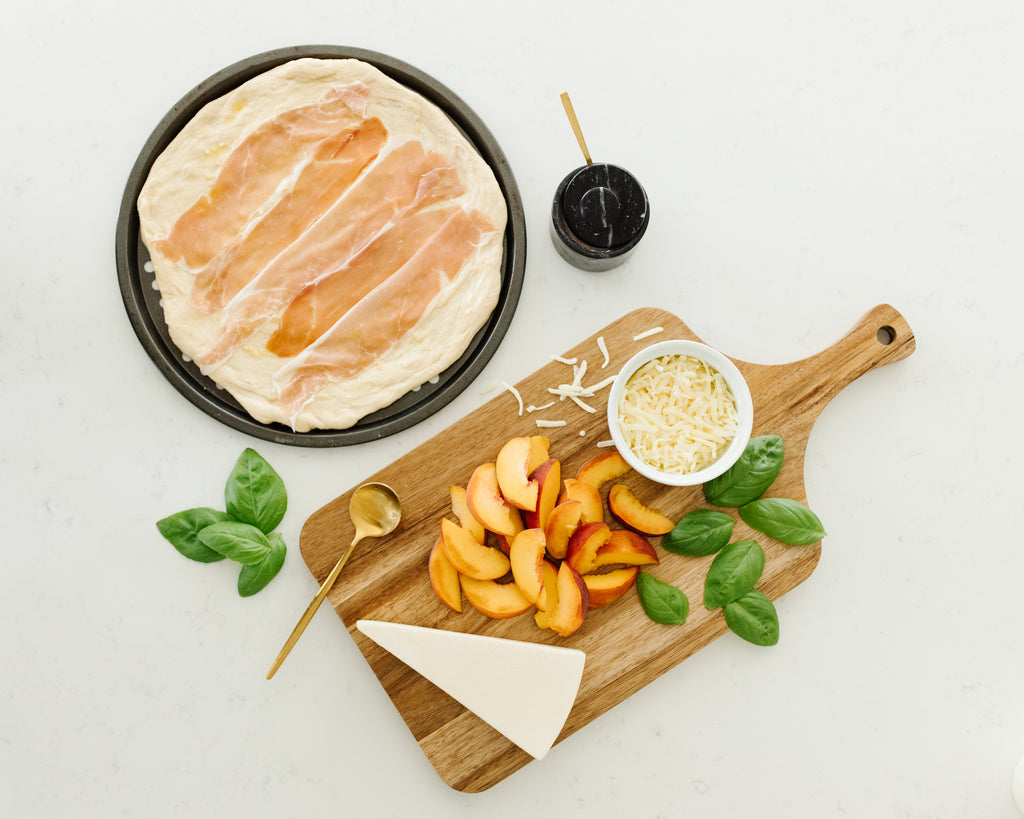 Cozy Earth's favorite grilled peach and prosciutto pizza ingredients