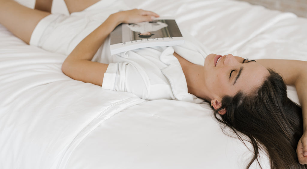 Woman in Cozy Earth short-sleeve pajamas with magazine