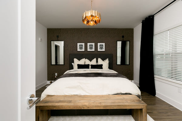 Bedroom with dark gray wallpaper accent wall