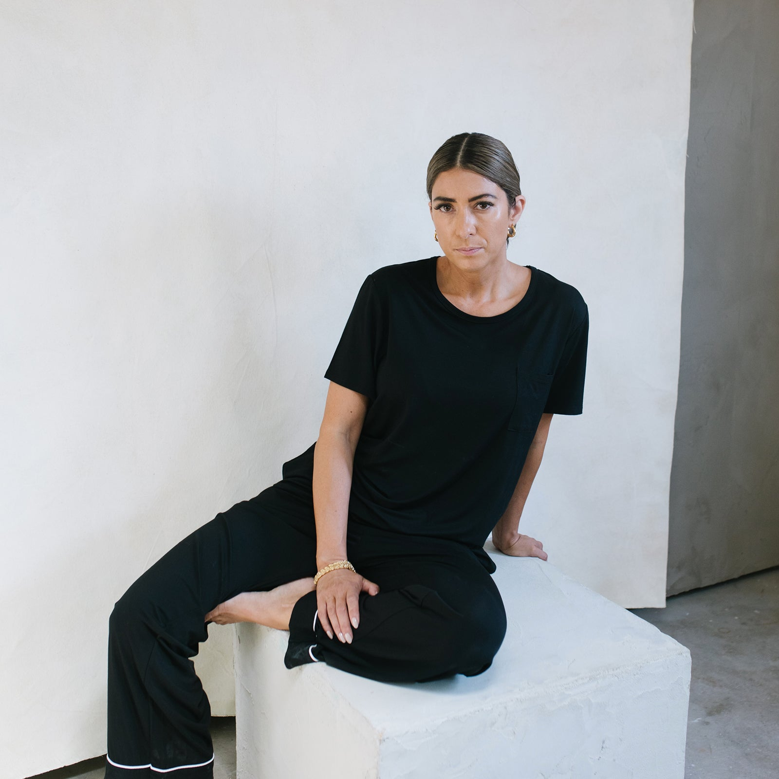 woman sitting on chair wearing black Stretch-Knit Bamboo Lounge Tee