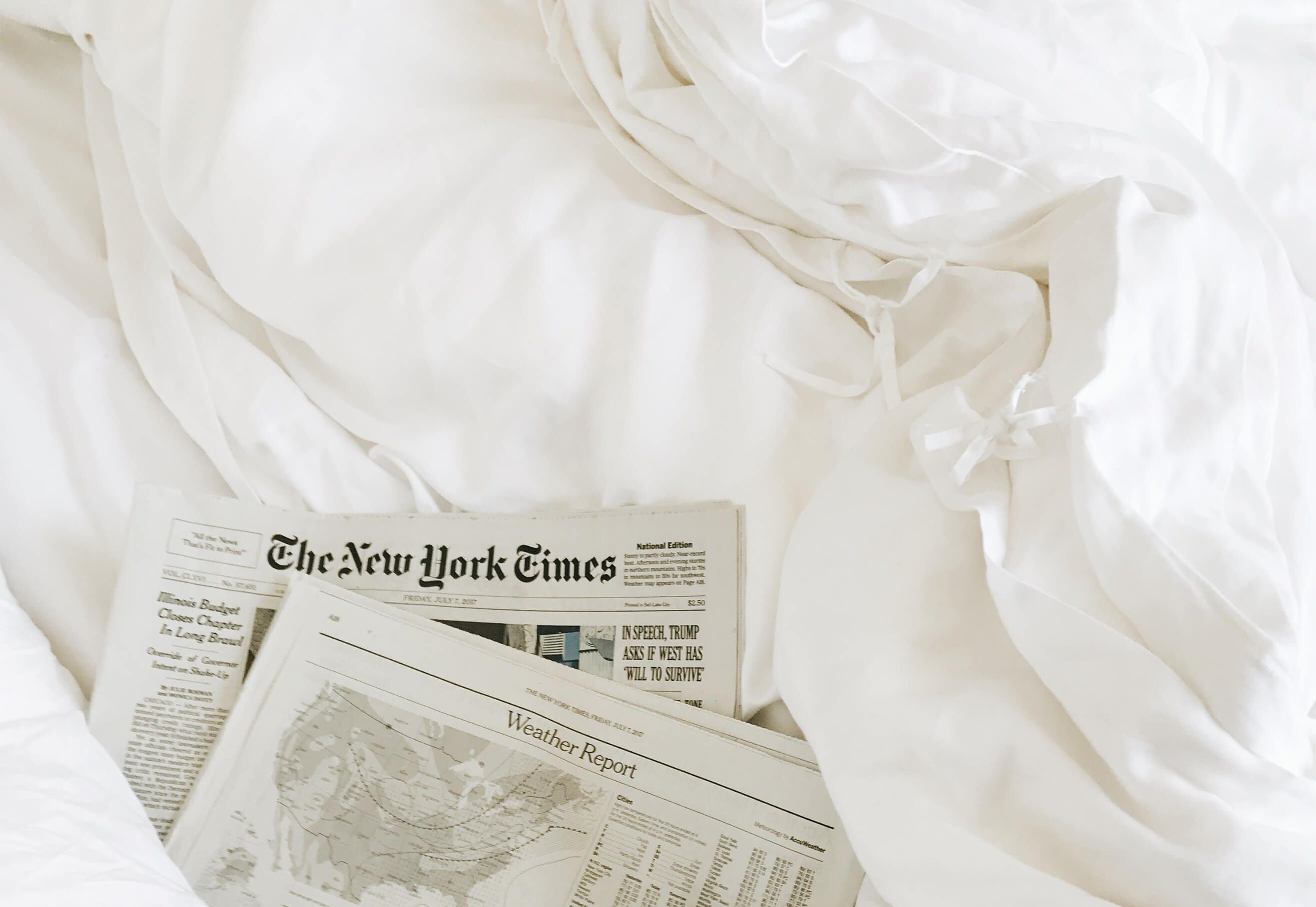 bamboo duvet cover on bed with news paper