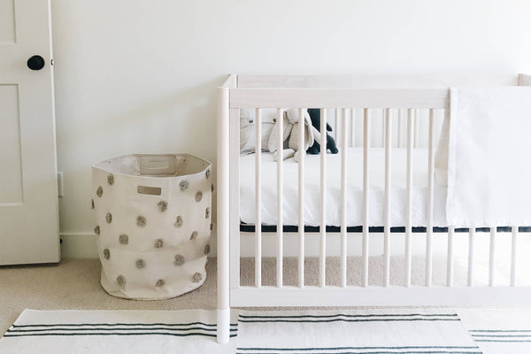 wooden crib bed made with bamboo crib sheet