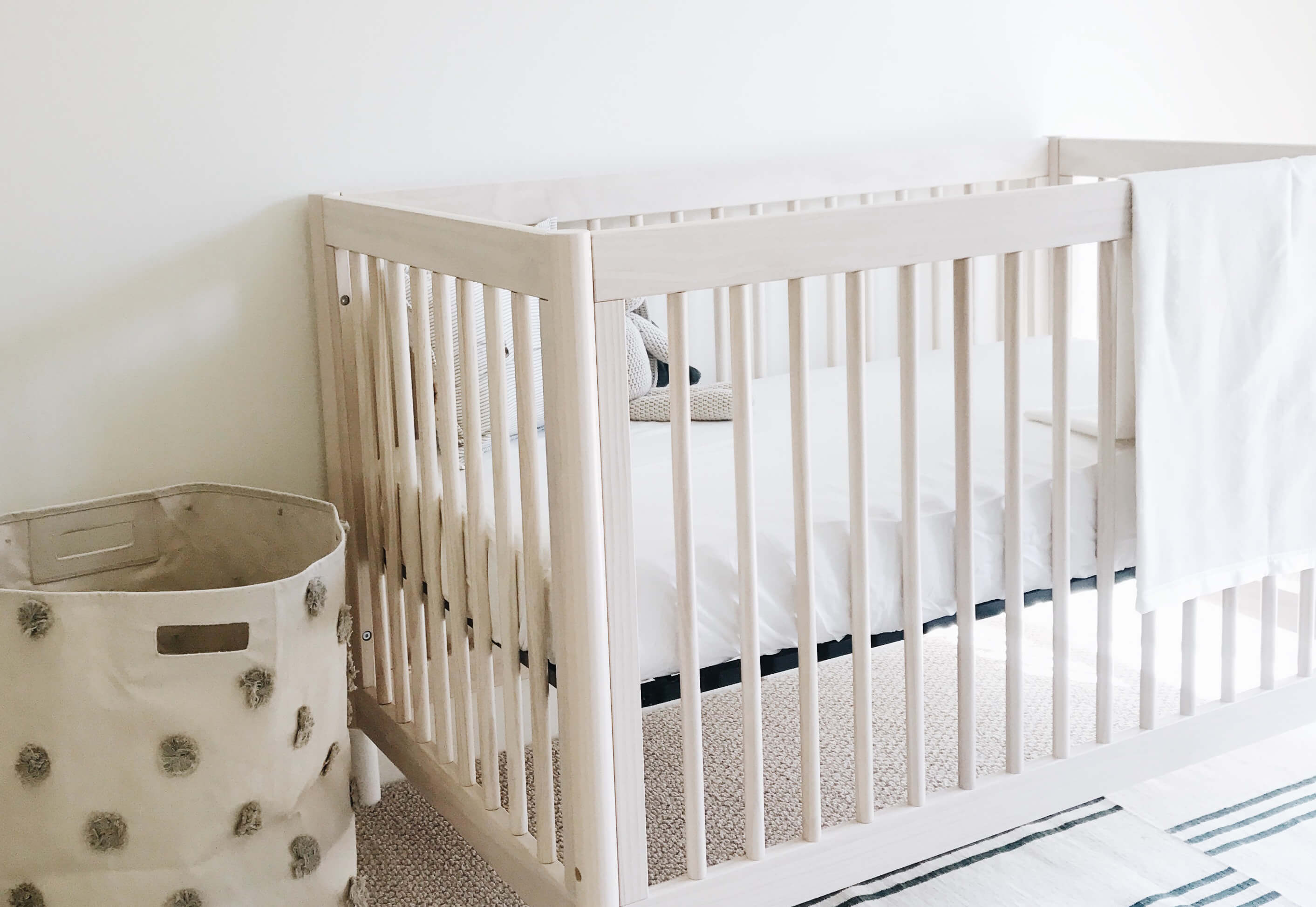 wooden crib bed made with bamboo crib sheets