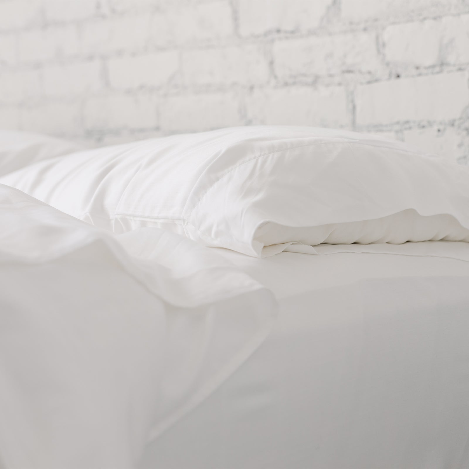 silk pillows on a bed