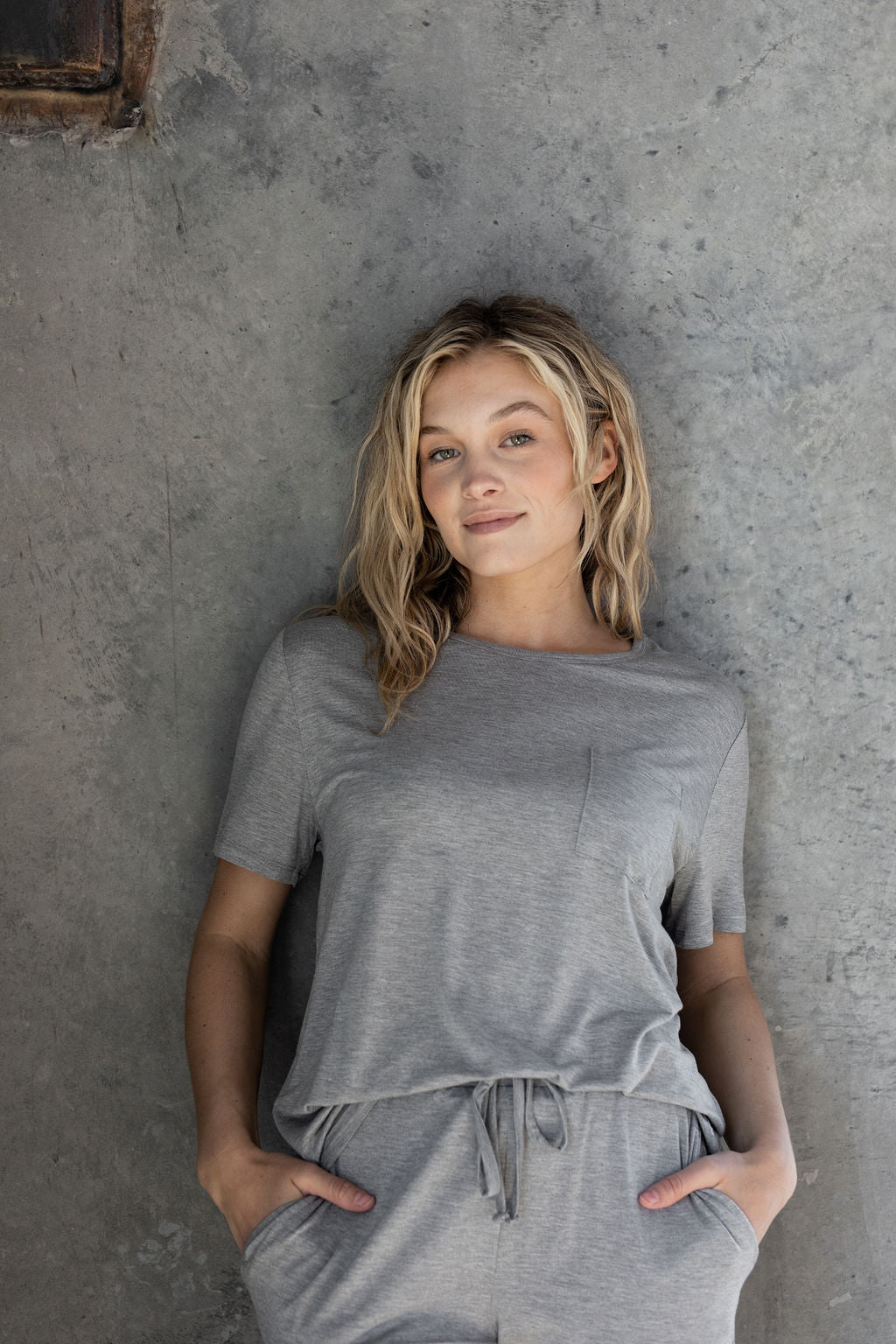 woman leaning against wall in gray Stretch-Knit Bamboo Lounge Tee