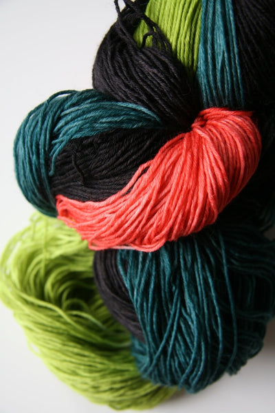 Some of our new colors together in a pile: Don't Be Koi; The Dark Knitnight; & That's A Moray