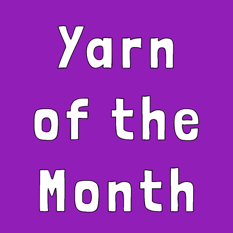 "purple square with white words reading ""yarn of the month"""
